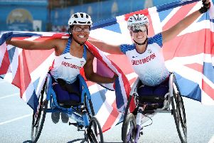Hannah Cockroft (right - 1st) and Kare Adenegan (left - 2nd) of Great Britain celebrate finishing first and second in the Women's 800m T34 during Day Eight of the IPC World Para Athletics Championships 2019 Dubai.