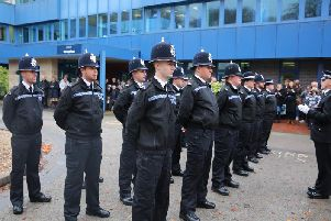 The new officers passing out at force HQ.