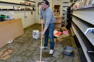 Worksop floods, Adam Hall of Comic Quest, Hardy Street, begins the clean up