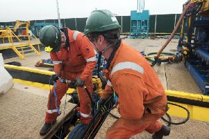 Workers at the Cuadrilla fracking site in Preston New Road, Little Plumpton, Lancashire
