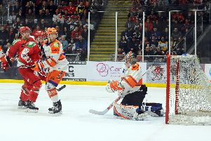 Ben O'Connor and Jackson Whistle watch the puck flash past them