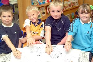 2003: This smiley bunch show off their artistic flare with their fabulous hand designs and drawings. Spot anyone you know?
