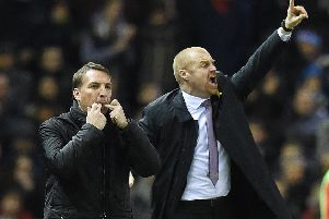 Burnley's Manager Sean Dyche and Liverpool's Manager Brendan Rodgers shout their instructions from the side lines''Photographer Dave Howarth/CameraSport''Football - Barclays Premiership - Liverpool v Burnley - Wednesday 4th March 2015 - Anfield - Liverpool''� CameraSport - 43 Linden Ave. Countesthorpe. Leicester. England. LE8 5PG - Tel: +44 (0) 116 277 4147 - admin@camerasport.com - www.camerasport.com