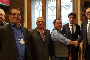 Minworkrs pension campaigners, from left: Barry Cox from Kent, Mick Newton of Mansfield, Norman Moore of Doncaster. Campaign organiser Les Moore shakes hands with Under-Secretary of State for Industry & Energy Richard Harrington, with Doncaster MP Ed Milliband.