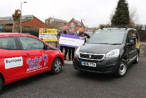 Bosses at Bank Park hand over a �130,000 cheque to Bluebell Wood Children's Hospice at the new car park.