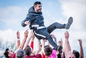 Boss Craig Denton is lifted aloft as Tigers celebrate title win. Pic credit: Mike Holmes.