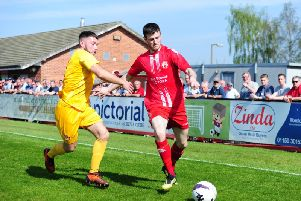 Jamie Walker in action against Walsall Wood. Photo by Craig Lamont.