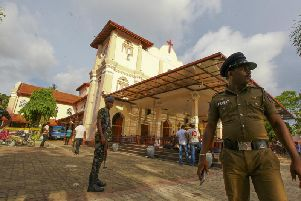 Sri Lankan army soldiers secure the area around St. Sebastian's Church damaged in blast in Negombo, north of Colombo, Sri Lanka, Sunday, April 21, 2019. More than hundred were killed and hundreds more hospitalized with injuries from eight blasts that rocked churches and hotels in and just outside of Sri Lanka's capital on Easter Sunday, officials said, the worst violence to hit the South Asian country since its civil war ended a decade ago. (AP Photo/Chamila Karunarathne)