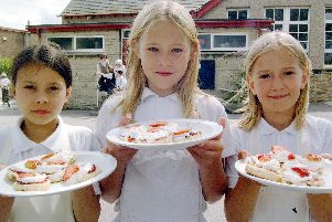 2001: This smiley trio look like they have been hard at work, maybe on a school trip, do you know?