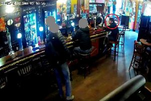 The CCTV image from a bar in Wigan