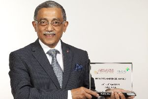 Surgeon Muhammad Shahed Quraishi with his award.