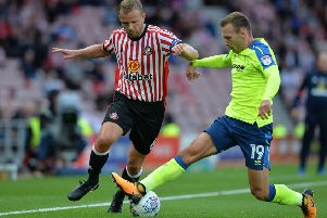 Rugged Sunderland midfielder Lee Cattermole (left), who is reportedly wanted by Sheffield Wednesday. (PHOTO BY: Mark Runnacles/Getty Images)