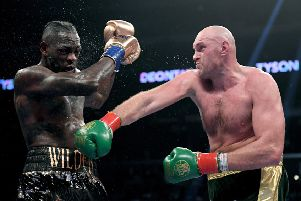 Tyson Fury punches Deontay Wilde in the seventh round fighting to a draw during the WBC Heavyweight Championship at Staples Center on December 1, 2018 in Los Angeles, California.  Photo by Harry How/Getty Images