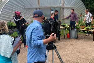 The Gardener's World team filming Callum and Tommie for the show.