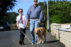 Kevin Beesting with his 11-year-old grandson Joe Wilkinson and Mr Beesting's  guide dog Spencer