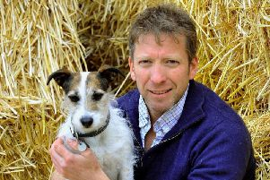 One of the Yorkshire Vets, Julian Norton, with his dog Emmy at Cannon Hall Farm near Barnsley, where Springtime on the Farm filmed for Channel Five. Picture: Gary Longbottom.