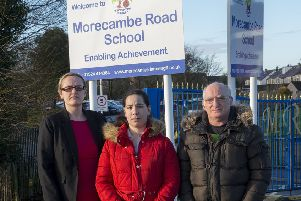 Lizzi Collinge with parents Nicola and Bob outside Morecambe Rd School.jpg