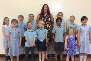 Siobhan Phillips is pictured with school council members at St Joseph's.