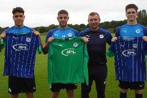 Nick Chadwick welcomes his three new signings to Wigan Athletic