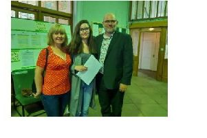Evie Cullen with her parents.
