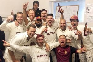 Woodlands celebrate winning the Bradford League after beating Undercliffe at the weekend. PIC: Brian Pearson