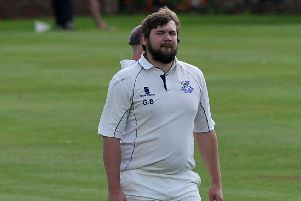 Captain George Bacon, who led Kimberley to the title with a century and a catch off the last ball.