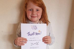 Isabella Brooke with her certificate from the Little Princess Trust.