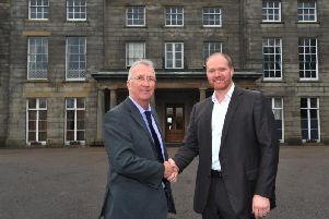 Council leader David Molyneux shakes hands with Craig Baker, director of Contessa Hotels, when the deal was first struck