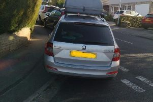 Police have been handing fines to cars outside schools in Leeds