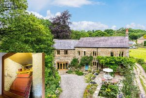 Little Mill, Smelthouses ' �800,000 with Dacre, Son & Hartley, 01423 711010 ' with the waterwheel on display in the reception hall (inset).