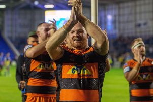 Castleford Tigers' players celebrate at full time after beating Warrington Wolves 14-12.