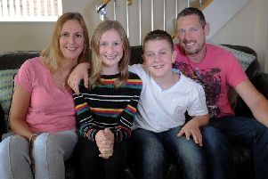 Lois Campling aged 13 with her mum Karen, her dad Lee and brother Connor aged 12, at their home at Garforth, Leeds.. Lois has recovered from a brain tumour.22nd September 2019. Picture by Simon Hulme