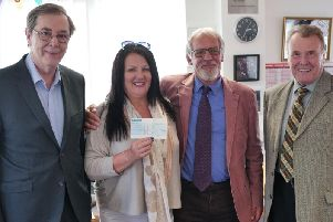 TEAM RISE manager Sharon Lees accepts the cheque from Paul Roberts, Ivor Emo and John Wilkinson of the Roses lodge.