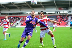 Rotherham's Carlton Morris, left, battles with Doncaster's Reece James earlier this season. Picture: Marie Caley.