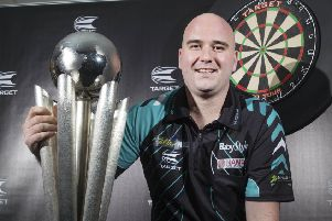 Rob Cross with the World Darts Championship Trophy. PIC: Steve Welsh/PA Wire