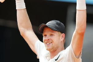 Kyle Edmund celebrates after beating Novak Djokovic 6-3, 2-6, 6-3 during the Madrid Open Picture: AP/Paul White