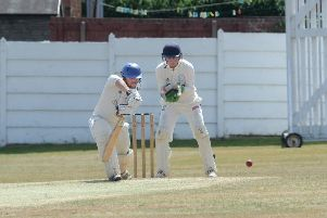 Townville opener Jonathan Booth hits another boundry at Farsley. PIC: Steve Riding
