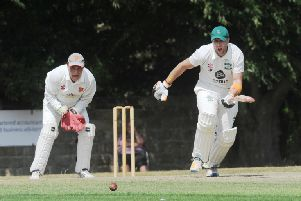 Otley's 'Jamie PIckering, who scored 108, goes on the attack with Ben Morley. Together they put on 132 for the first wicket in the 125-run win over Pool. PIC: Steve Riding