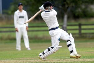 Redmond Bolton hits one of his four sixes scoring 44 off 22 balls for Burley.