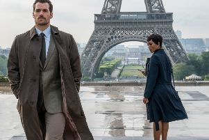 Henry Cavill as August Walker and Angela Bassett as Erica Sloane. PIC: PA