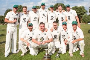 Waddilove Cup winners Otley celebrate their final victory over Guiseley. PIC: John Heald