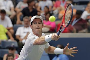 Andy Murray returns against James Duckworth during their first round of the US Open clash in New York. Picture: AP/Andres Kudacki