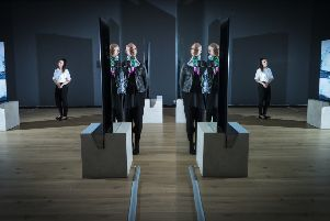 Lauran Masterman (left) and Vanessa Myrie (centre) are reflected in mirrors that form part of an art installation at York Mediale.