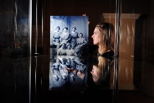 Vicky Siviter with one of the old photographs. Picture by Simon Hulme