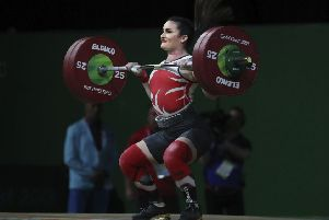 Leeds' Sarah Davies on her way to the silver medal in the  women's 69kg weightlifting final at the Commonwealth Games earlier this year.