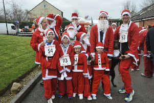 GREAT FUN: Some of the participants in last year's hospice Santa dash.