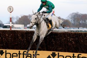 Bristol De Mai ridden by Daryl Jacob clears the last fence and wins the Betfair  Chase at Haydock Park