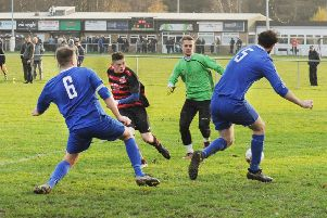 Josh Whiteley, of Stanley United, beats  Alwoodley goalkeeper Damian Brodowski but his shot is wide during Saturday's Old Boys' Shield encounter. PIC: Steve Riding