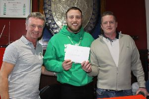 From left to right: Dave Rushton (organiser) Liam Everett  (Macmillan Care Advisor) and Lee Garrad with the envelope of cash collected from anglers at Knotford.