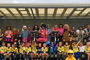 The under 9s team with parents in fancy dress at the cycling fundraiser.